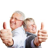 happy_elderly_senior_couple_holding_their_thumbs_up200
